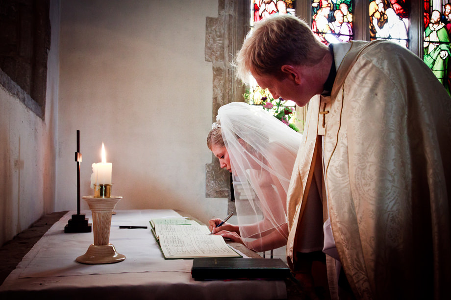 Somerset Bride Signs Wedding Registry by Candlelight