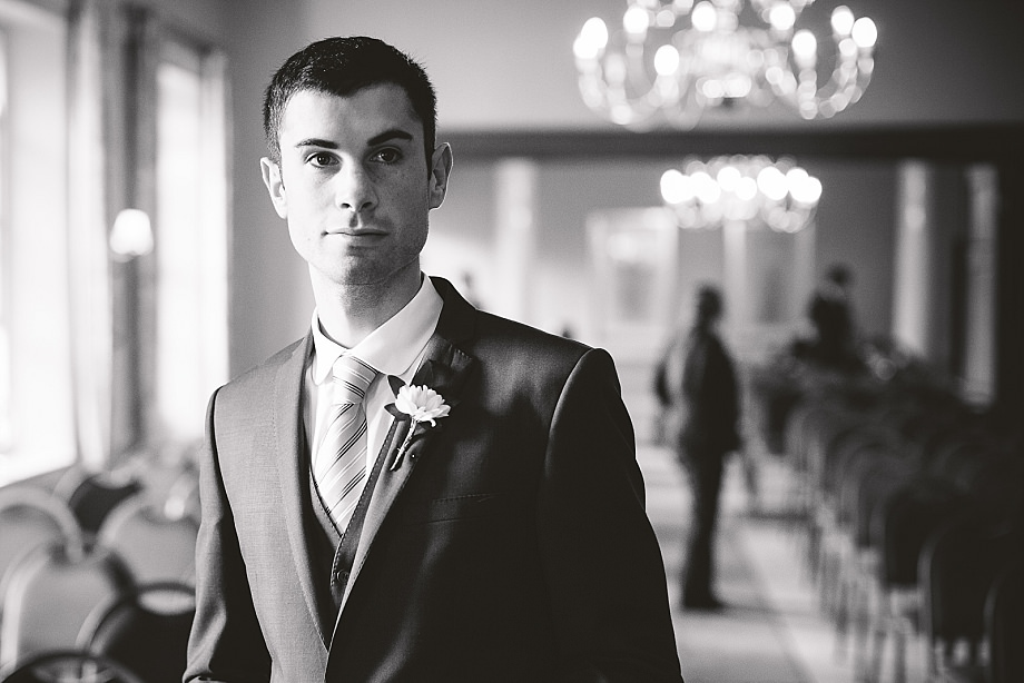 black and white portrait of groom in holbrook house in dorset