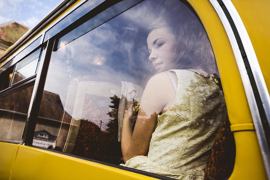 bridesmaid in a yellow vintage bus in dorset