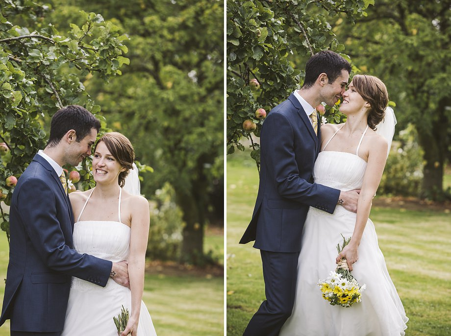 bride and groom in orchard in sherborne