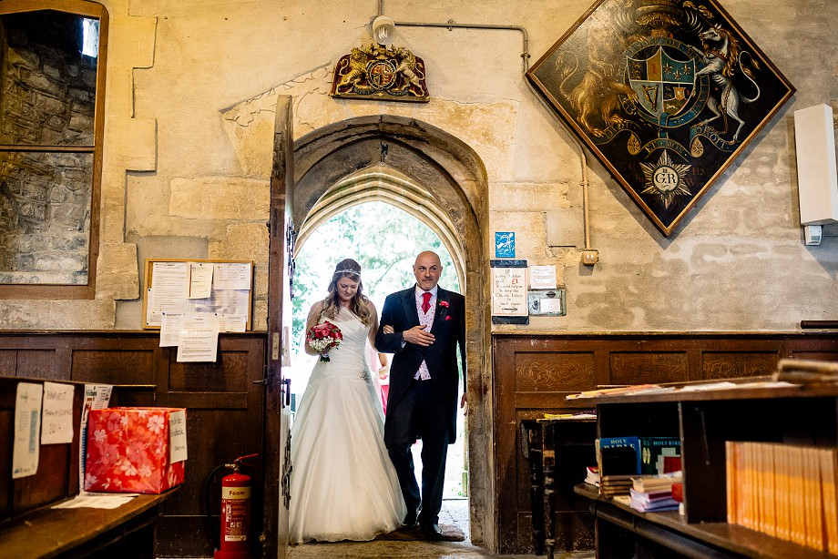 bride and father in church