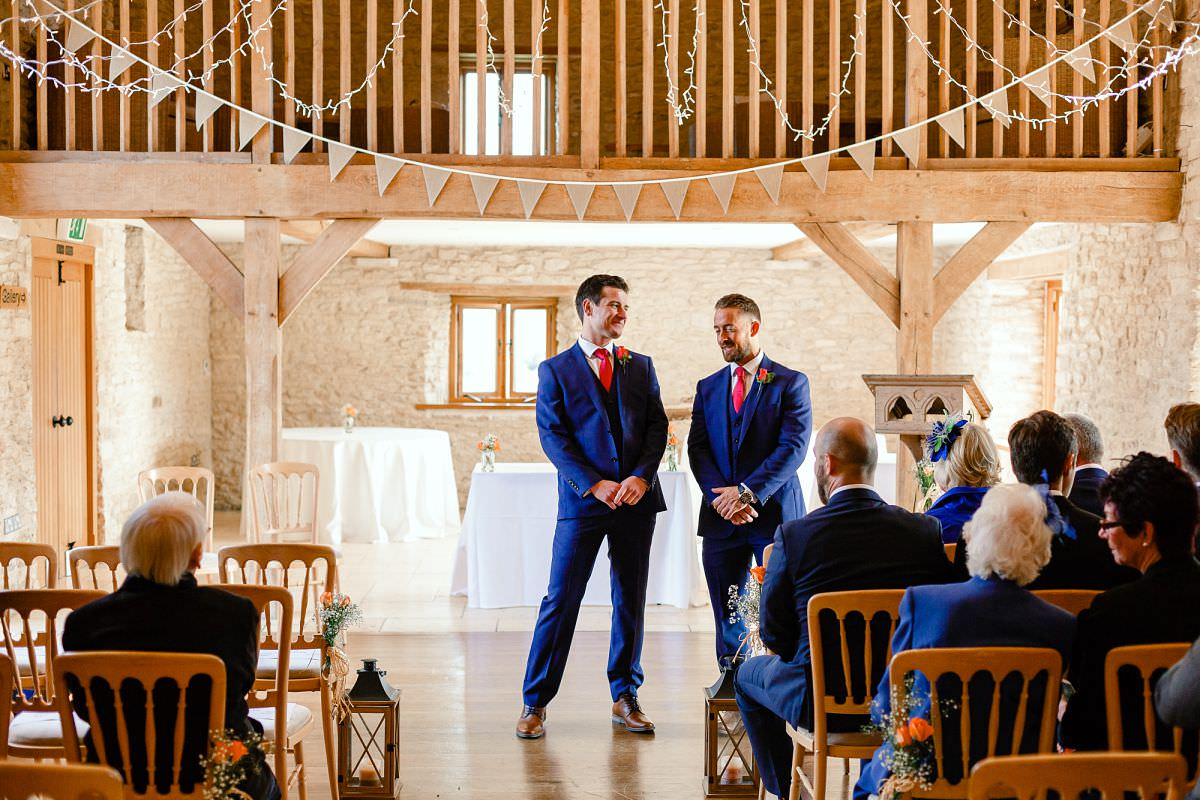 groom waiting for bride at kingscote barn