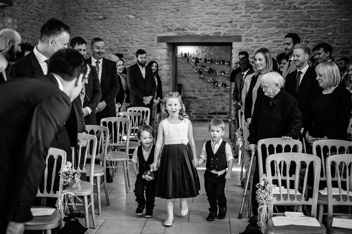 pageboys and flowergirl arive at a wedding