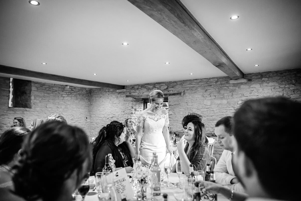guests mingling at kingscote barn wedding venue