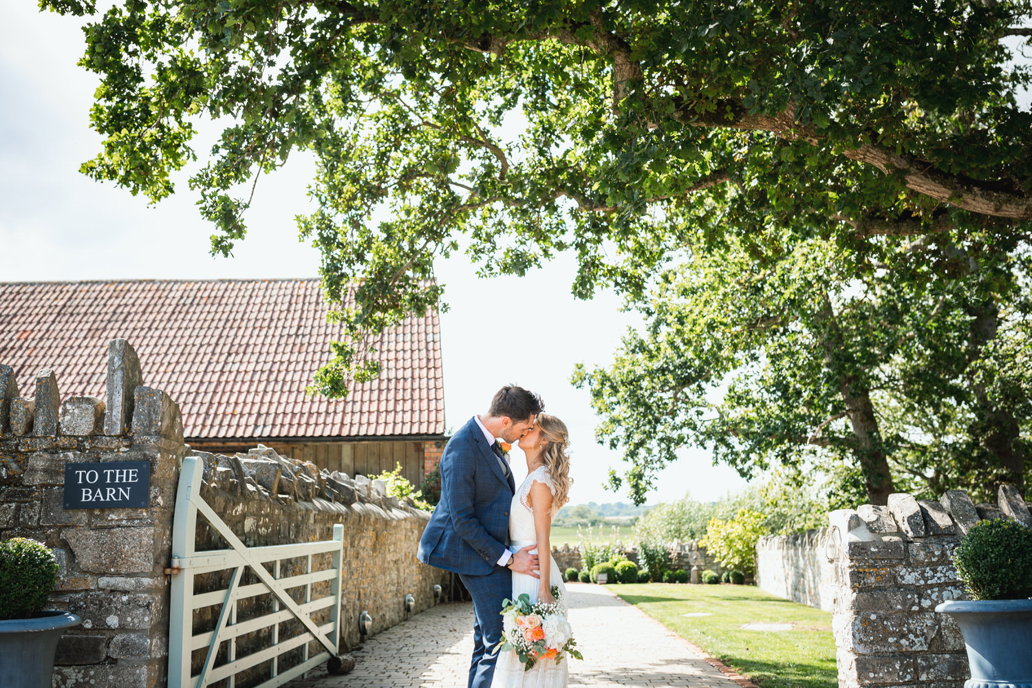 almonry barn bride and groom kiss