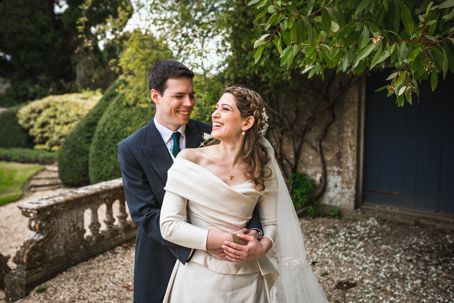 bride and groom smiling at brympton house