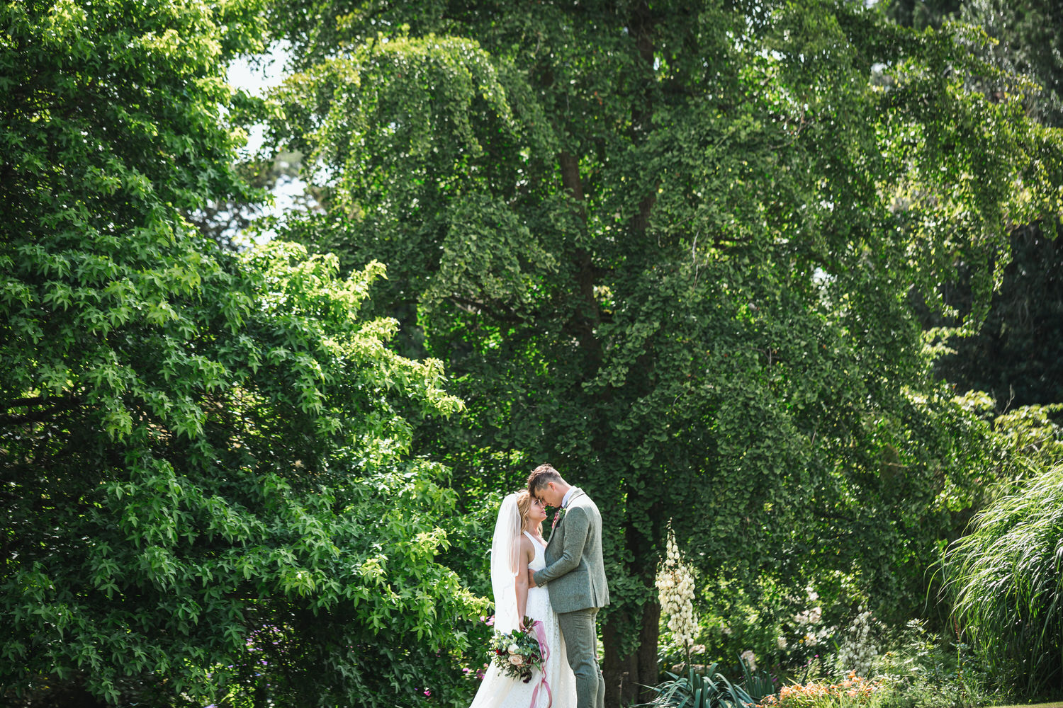 bride and groom kissing at pennard house in somerset