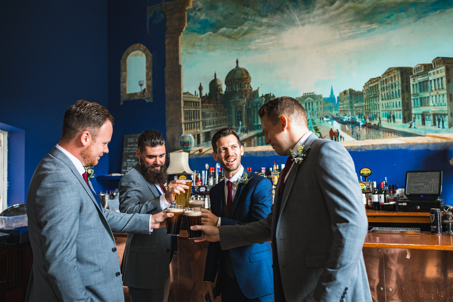 groomsmen cheers at bar