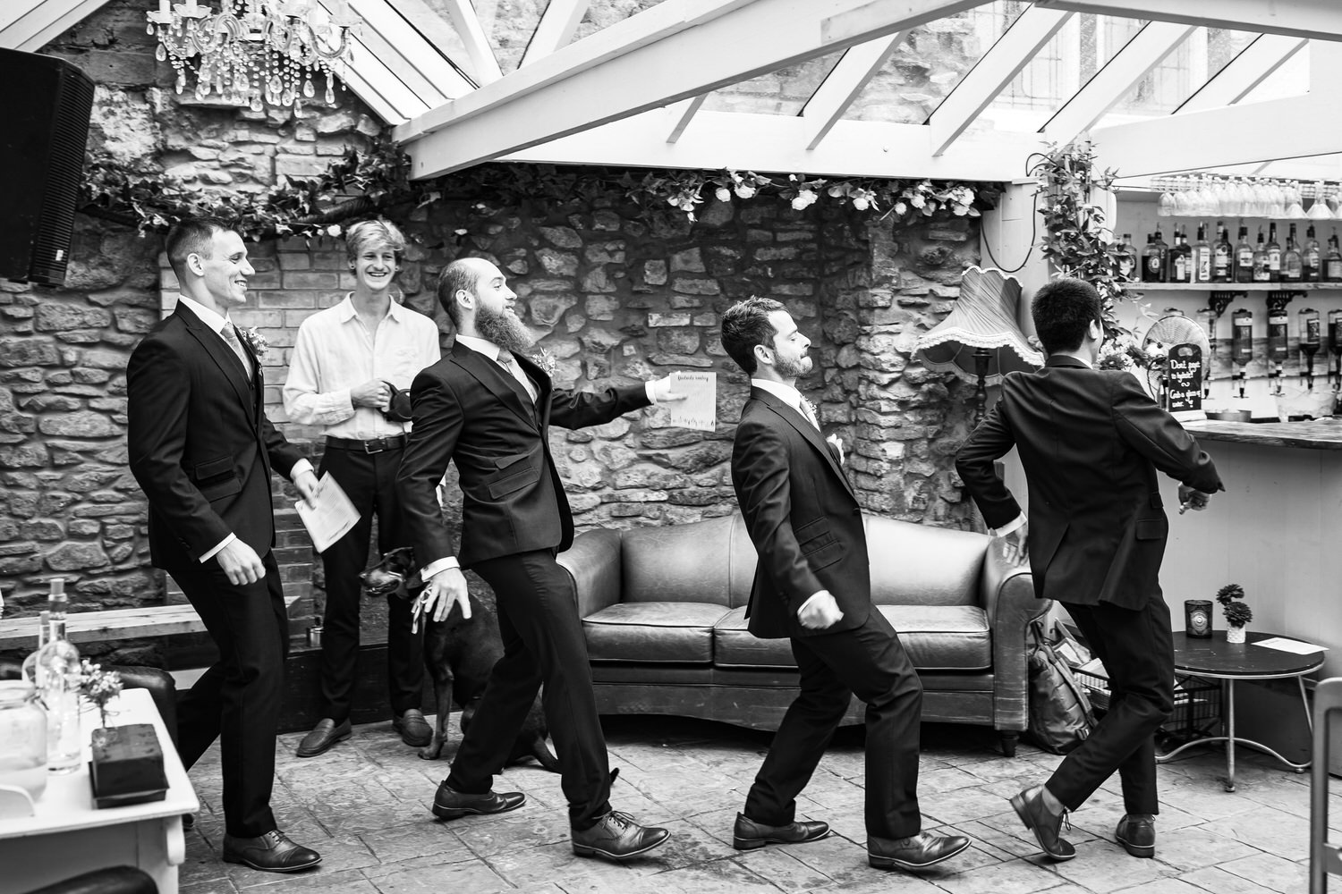 groomsmen dance into ceremony