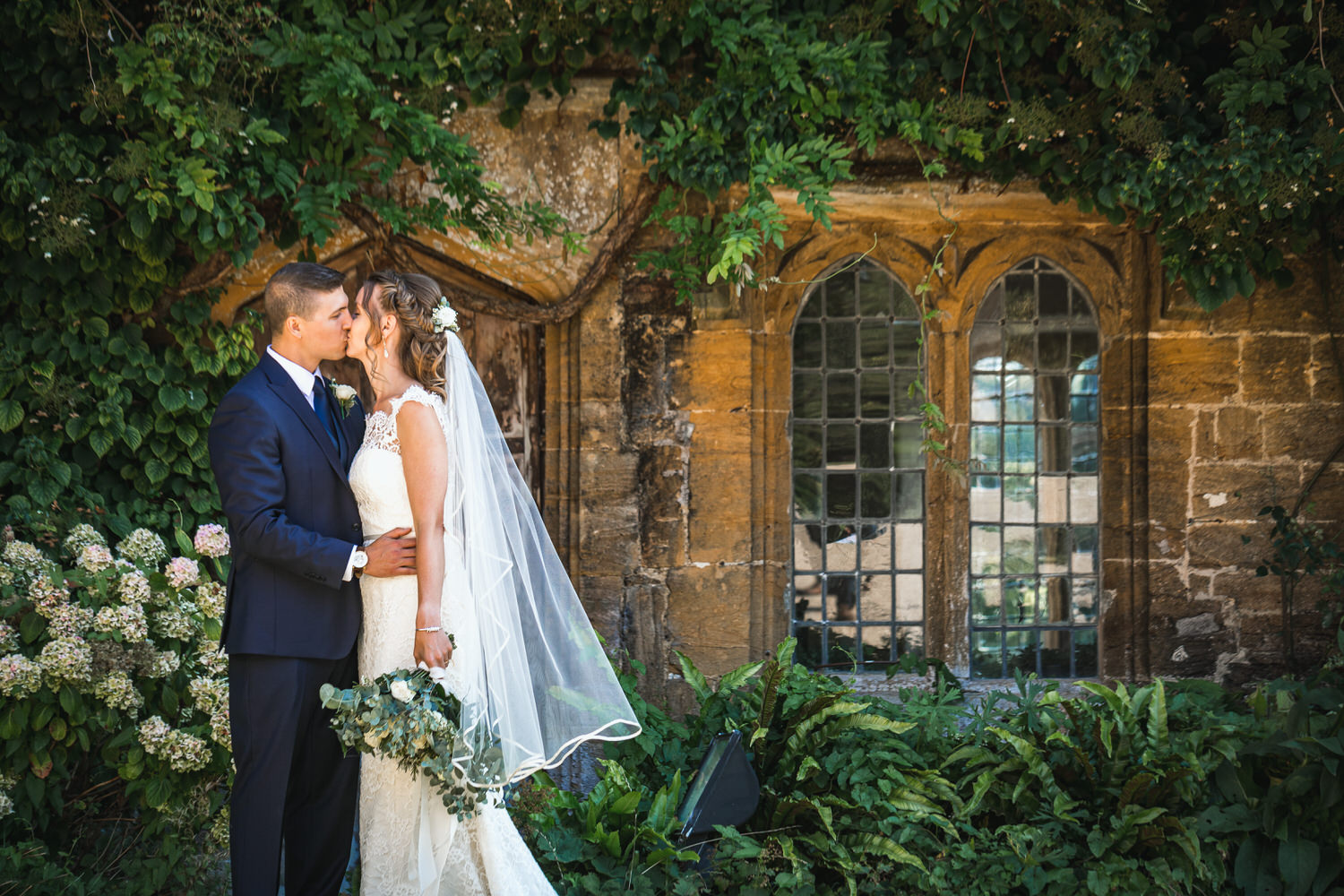 bride and groom kissing at brympton house