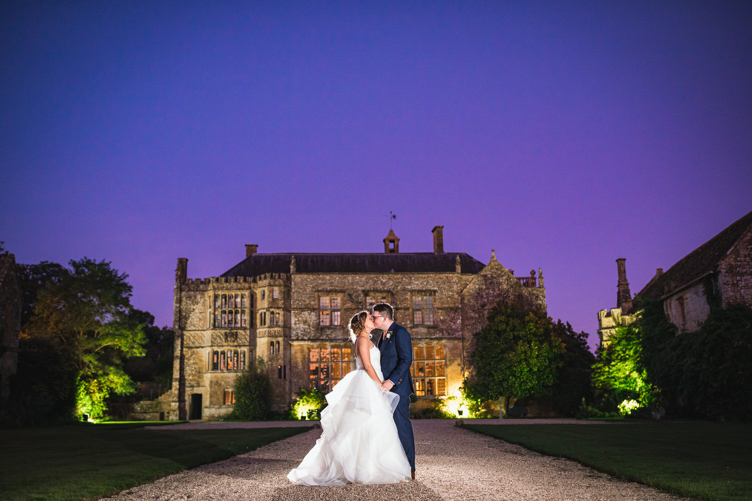 night portrait of bride and groom at brympton house