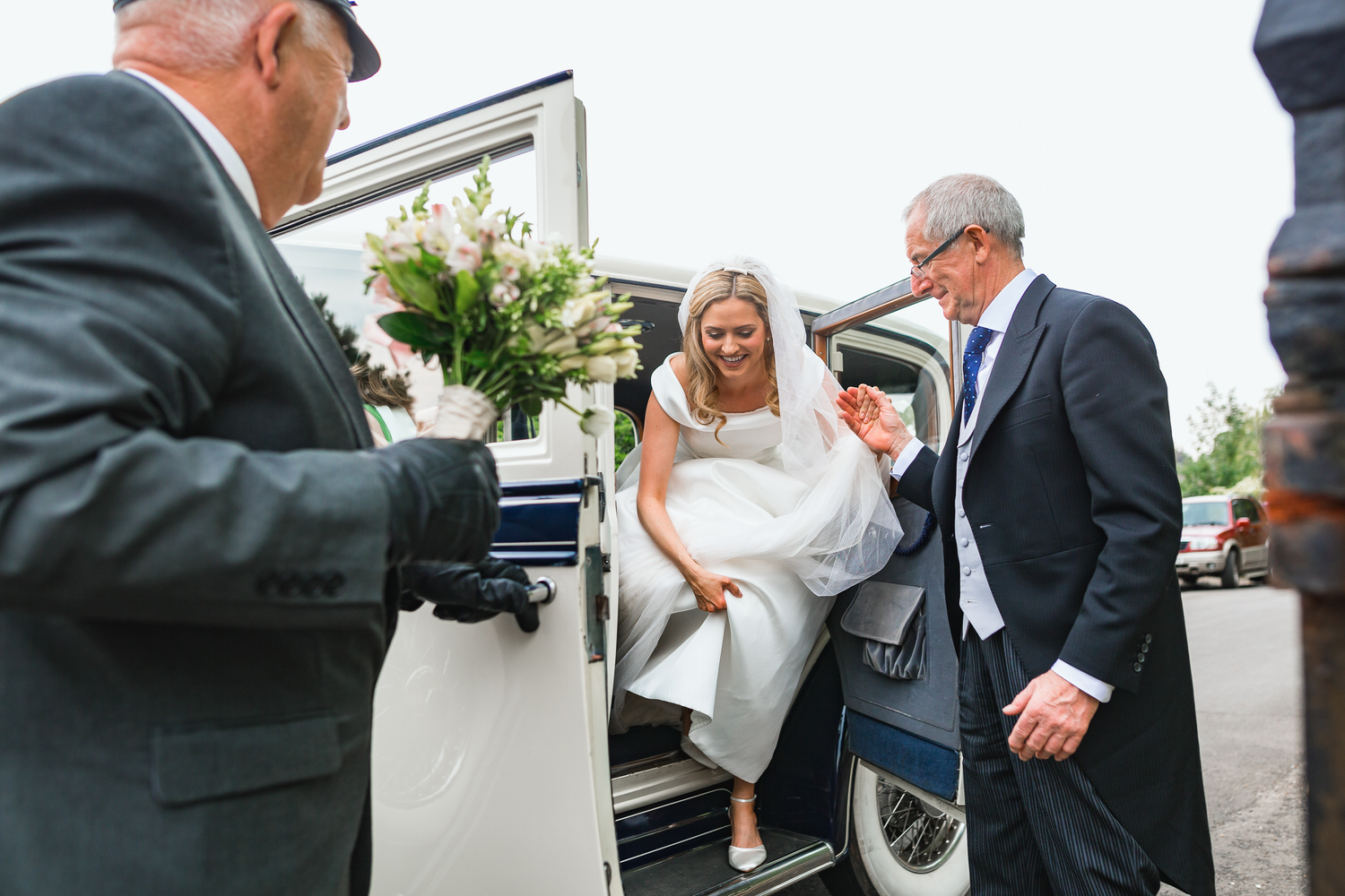 bride getting out of car at her wedding in somerset