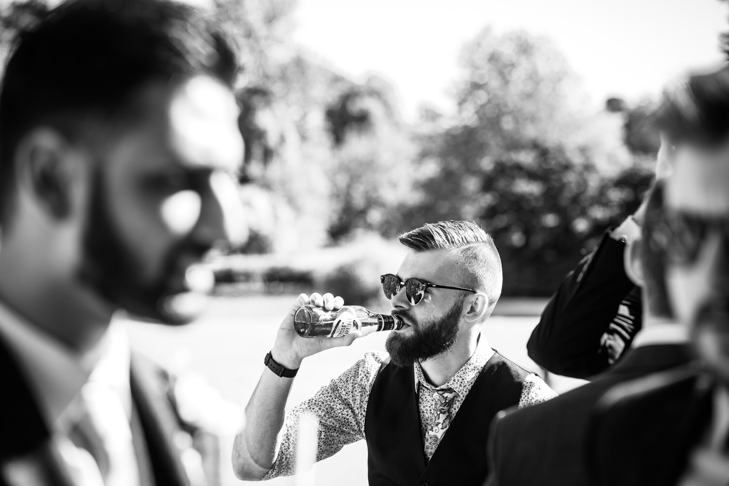 wedding guests drinking bottled beer