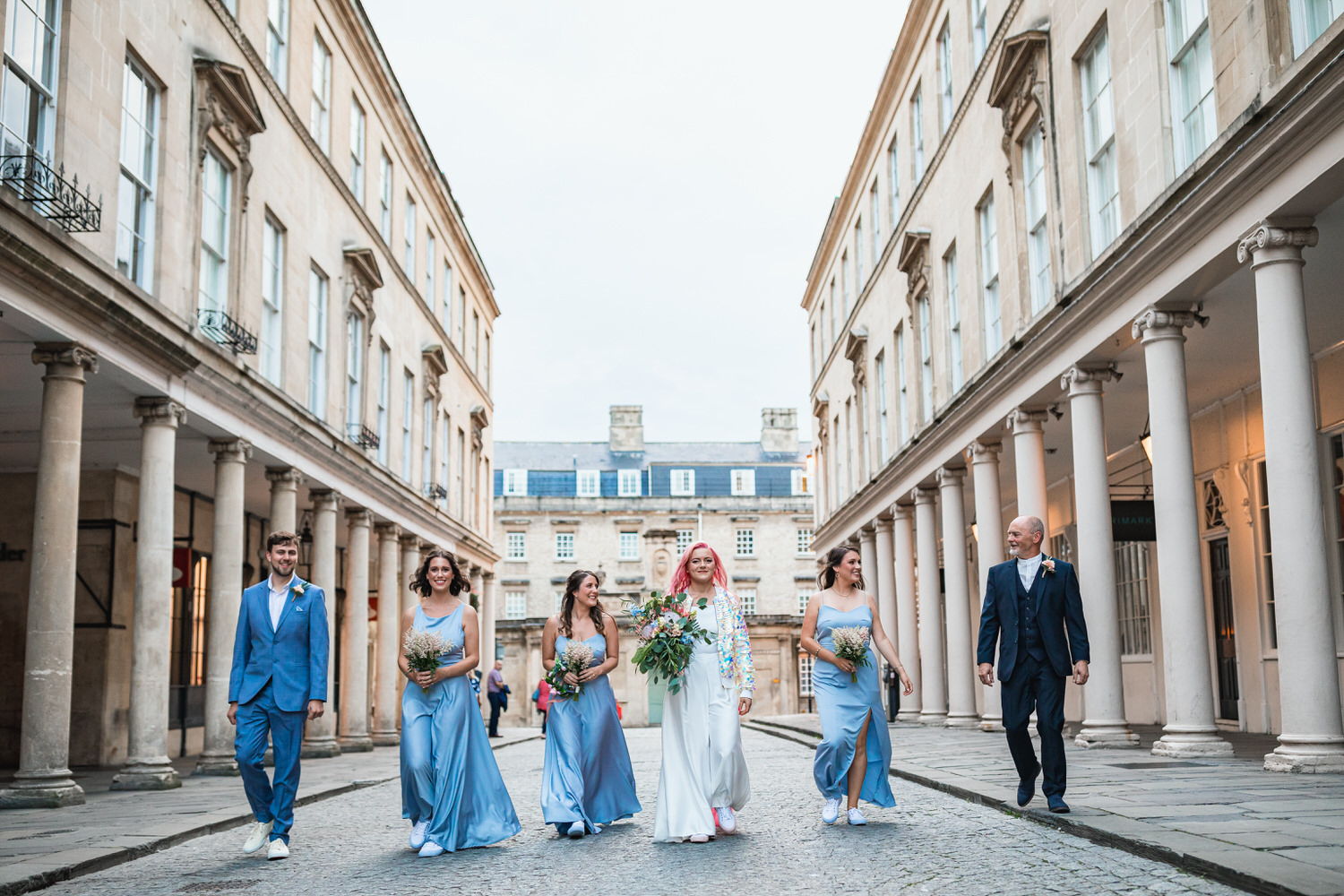 bridal party walking through bath city centre